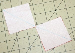 "1. Mark a diagonal on the wrong side of the 2 larger white squares, pair with an equal sized square in print and sew 1/4"" away from both sides the marked line."