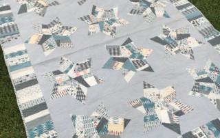"Splendid Stars Quilt - ""made fabric"" stars set in a soft grey background - amyscreativeside.com"